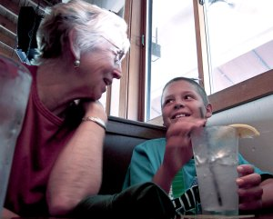 Isaac and Nana share some laughs while waiting for burgers